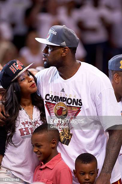 NBA Finals Miami Heat LeBron James victorious with wife Savannah and sons LeBron Jr and Bryce after winning game and series vs Oklahoma City Thunder...