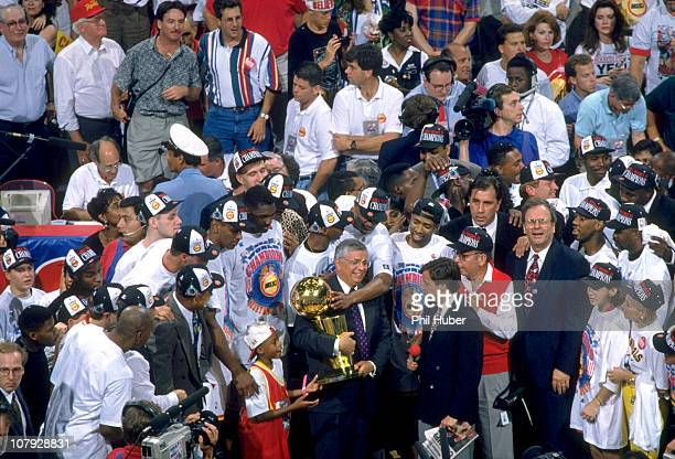 NBA Finals NBA commissioner David Stern with NBC announcer Bob Costas presenting Larry O'Brien Championship trophy to victorious Houston Rockets team...
