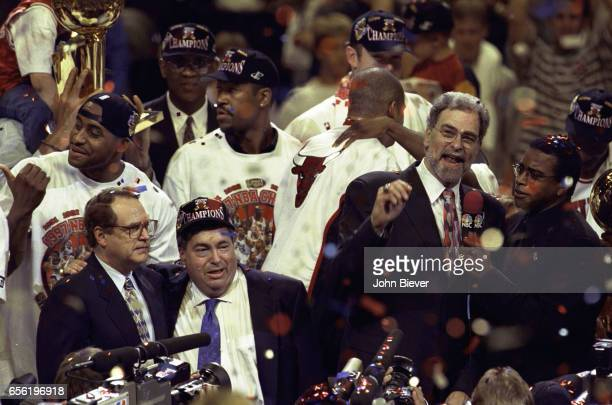 NBA Finals NBC reporter Ahmad Rashad on court talking with Chicago Bulls coach Phil Jackson with Bulls Chairman Jerry Reinsdorf and General Manager...