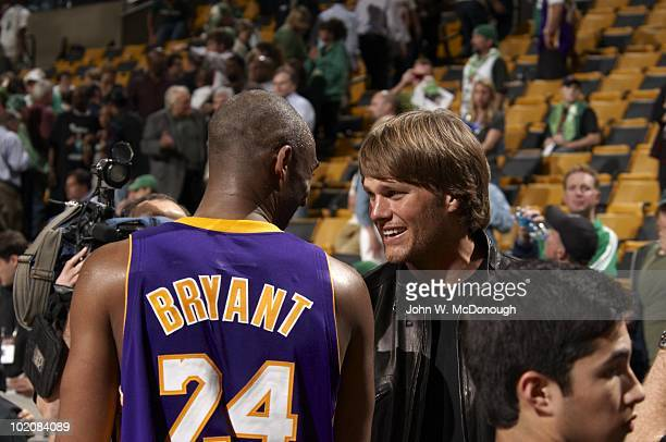 NBA Finals New England Patriots QB Tom Brady casual shaking hands with Los Angeles Lakers Kobe Bryant after Game 3 vs Boston Celtics Boston MA...