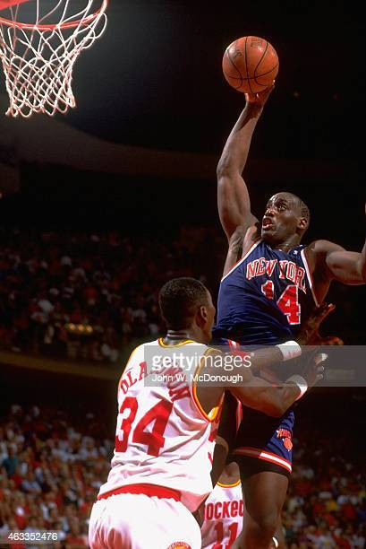 NBA Finals New York Knicks Anthony Mason in action vs Houston Rockets Hakeem Olajuwon at The Summit Game 2 Houston TX CREDIT John W McDonough