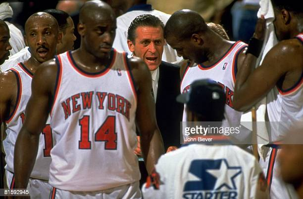 Basketball: NBA Finals, New York Knicks coach Pat Riley with Anthony Mason and team during game timeout of Game 3 vs Houston Rockets, New York, NY...