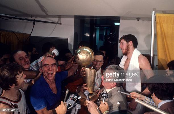 NBA Finals Portland Trail Blazers coach Jack Ramsay victorious with NBA Championship Trophy and NBA Commisioner Larry O'Brien and Bill Walton in...
