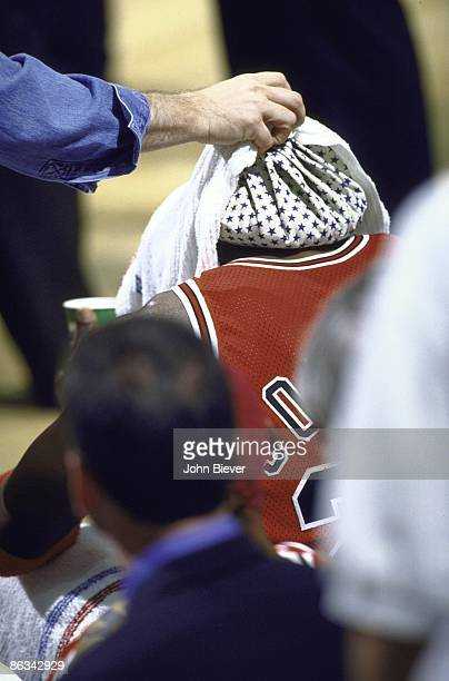 NBA Finals Rear view of Chicago Bulls Michael Jordan on sidelines bench with ice pack on back of neck during Game 5 vs Utah Jazz Jordan had a stomach...
