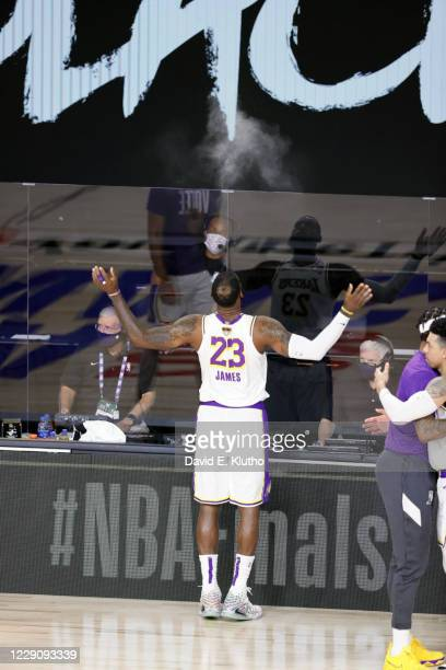Finals: Rear view of Los Angeles Lakers tossing talc powder in air on court before game vs Miami Heat at AdventHealth Arena. Game 3. Orlando, FL...