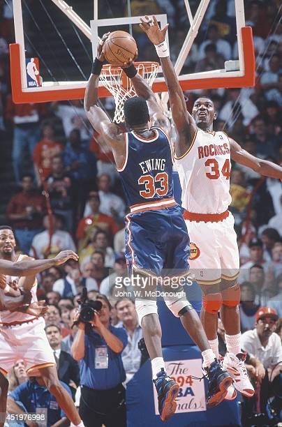 NBA Finals Rear view of New York Knicks Patrick Ewing in action shooting vs Houston Rockets Hakeem Olajuwon at The Summit Game 7 Houston TX CREDIT...