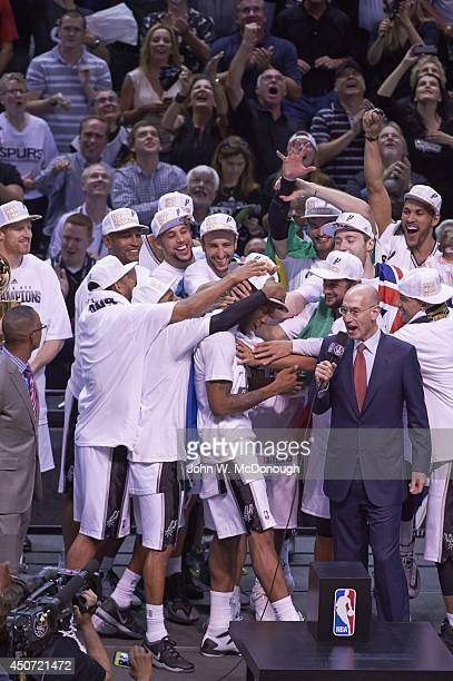 NBA Finals San Antonio Spurs Kawhi Leonard victorious as he is about to receive MVP trophy with NBA commissioner Adam Silver after winning game and...