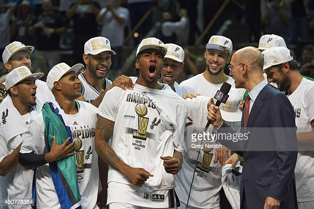 NBA Finals San Antonio Spurs Kawhi Leonard victorious about to receive MVP trophy announced by NBA commissioner Adam Silver after winning game and...