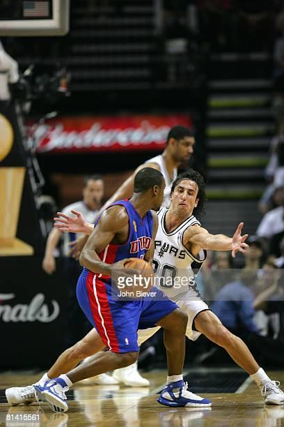 Basketball NBA finals San Antonio Spurs Manu Ginobili in action playing defense vs Detroit Pistons Lindsey Hunter San Antonio TX 6/9/2005