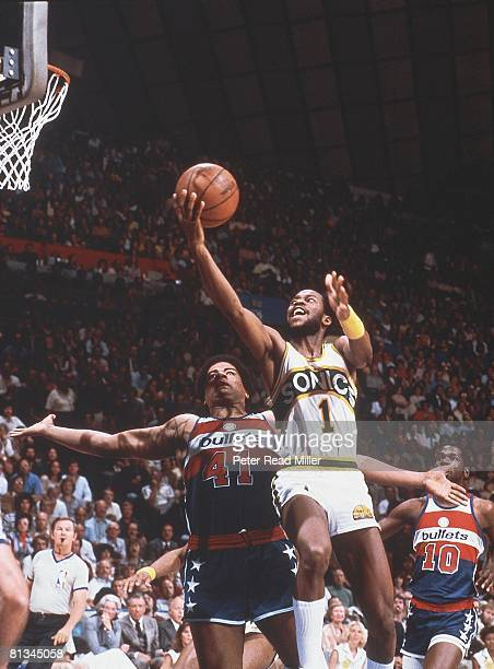 Basketball NBA Finals Seattle SuperSonics Gus Williams in action layup vs Washington Bullets Wes Unseld Game 4 Cover Seattle WA 5/29/1979