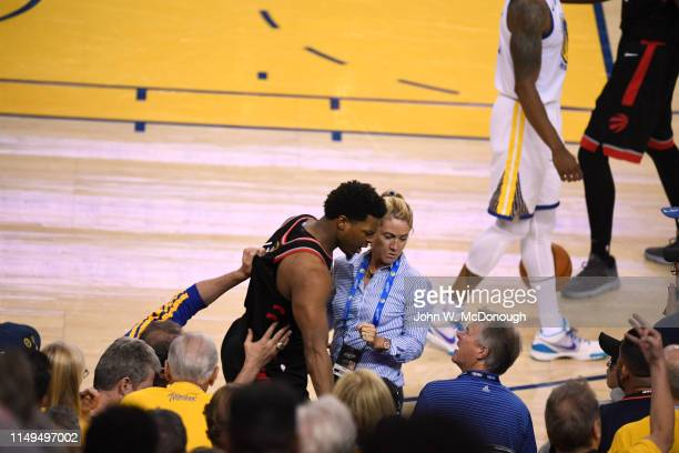 NBA Finals Toronto Raptors Kyle Lowry speaks with Golden State Warriors minority owner Mark Stevens after colliding into stands during Game 3 at...