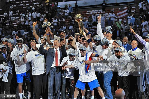 NBA Finals View of Dallas Mavericks team victorious with Larry O'Brien Championship trophy after winning Game 6 and championship series vs Miami Heat...