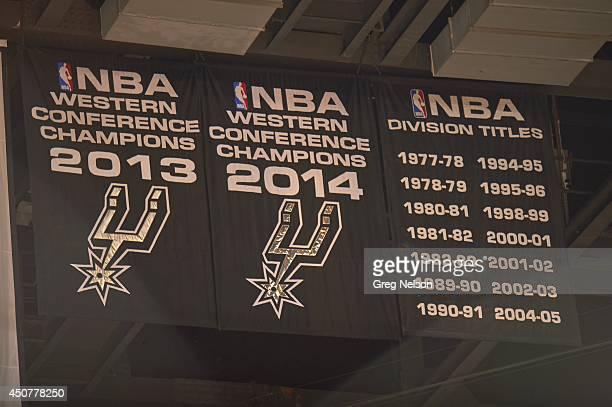 NBA Finals View of San Antonio Spurs two Western Conference championship banners and list of NBA Division titles in rafters before game vs Miami Heat...