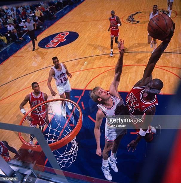 NBA Playoffs Aerial view of Chicago Bulls Michael Jordan in action dunk vs Cleveland Cavaliers Craig Ehlo Game 5 Richfield OH 5/7/1989 CREDIT Carl...