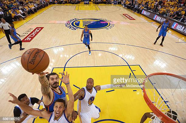 NBA Playoffs Aerial view of Oklahoma City Thunder Steven Adams in action vs Golden State Warriors Stephen Curry at Oracle Arena Game 5 Oakland CA...
