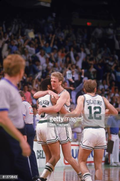 Basketball NBA Playoffs Boston Celtics Larry Bird victorious hugging Dennis Johnson after Johnson made game winning layup on Bird's steal off inbound...