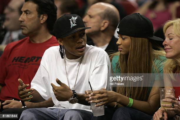 Basketball NBA playoffs Celebrity artists Bow Wow and Ciara in stands during Detroit Pistons vs Miami Heat game Miami FL 5/25/2005