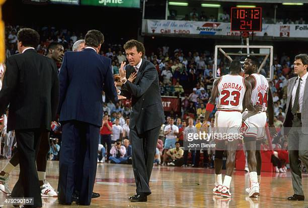 NBA Playoffs Chicago Bulls coach Doug Collins and Detroit Pistons coach Chuck Daly after altercation between Charles Oakley and Rick Mahorn at...