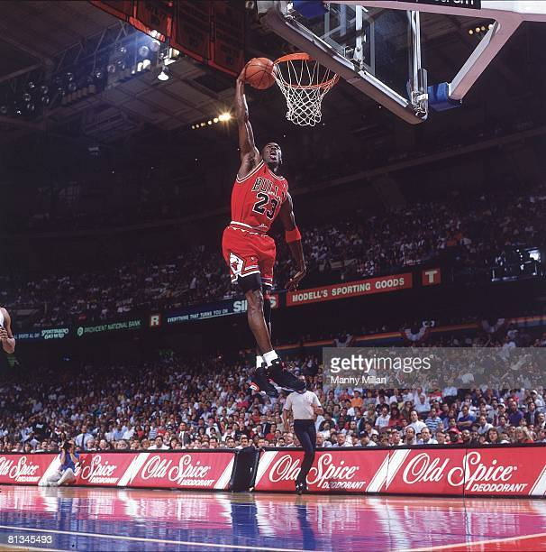 Basketball NBA Playoffs Chicago Bulls Michael Jordan in action making dunk vs Philadelphia 76ers Game 3 Philadelphia PA 5/10/1991