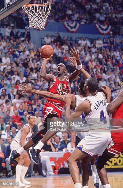 Playoffs: Chicago Bulls Michael Jordan in action, taking shot vs Cleveland Cavaliers John Williams and Mike Sanders . Game 5. Cover. Richfield, OH...