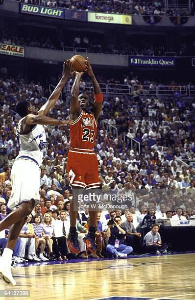 Playoffs: Chicago Bulls Michael Jordan in action, taking shot vs Utah Jazz Chris Morris . Game 5. Jordan had a stomach virus that caused a fever and...