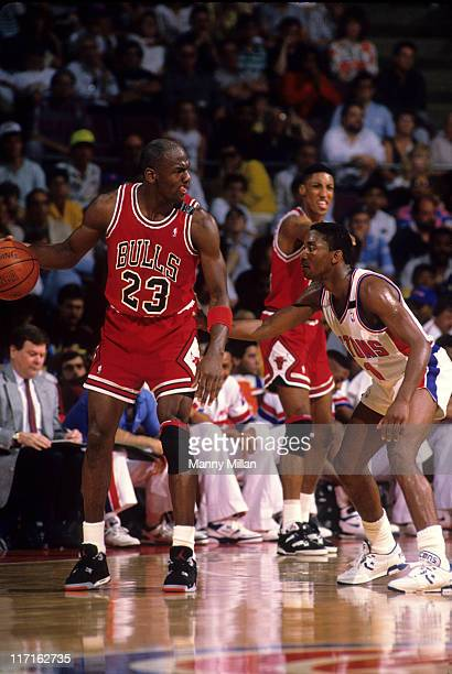 NBA Playoffs Chicago Bulls Michael Jordan in action vs Detroit Pistons Isiah Thomas during game at The Palace Game 1 Auburn Hills MI CREDIT Manny...
