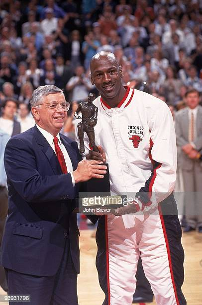 Playoffs: Chicago Bulls Michael Jordan receiving Maurice Podoloff MVP Trophy from NBA Commissioner David Stern before game vs Orlando Magic. Game 2....