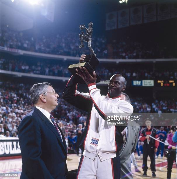 Basketball NBA Playoffs Chicago Bulls Michael Jordan victorious with MVP trophy and commissioner David Stern before game vs Cleveland Cavaliers Game...