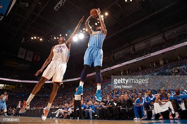NBA Playoffs Denver Nuggets Wilson Chandler in action shot vs Oklahoma City Thunder Kevin Durant at Oklahoma City Arena Game 1 Oklahoma City OK...