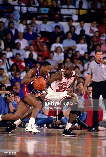 NBA Playoffs Detroit Pistons Isiah Thomas in action during game vs Chicago Bulls Michael Jordan at Chicago Stadium Game 3 Chicago IL CREDIT Manny...