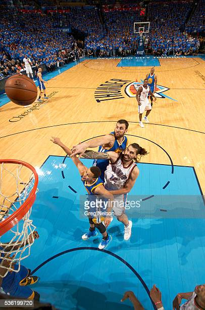 NBA Playoffs Golden State Warriors Andrew Bogut and Stephen Curry in action vs Oklahoma City Thunder Steven Adams at Chesapeake Energy Arena Game 6...
