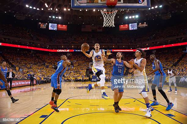 NBA Playoffs Golden State Warriors Stephen Curry in action vs Oklahoma City Thunder Steven Adams at Oracle Arena Game 2 Oakland CA CREDIT John W...
