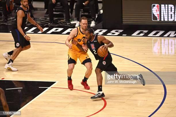 Playoffs: Los Angeles Clippers Kawhi Leonard in action, dunking vs Utah Jazz Bojan Bogdanovic at Staples Center. Game 4. Los Angeles, CA 6/14/2021...