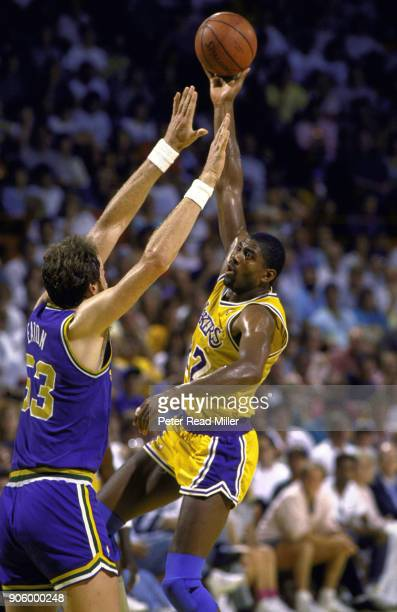 NBA Playoffs Los Angeles Lakers Magic Johnson in action hook shot vs Utah Jazz Mark Eaton at The Forum Inglewood CA CREDIT Peter Read Miller