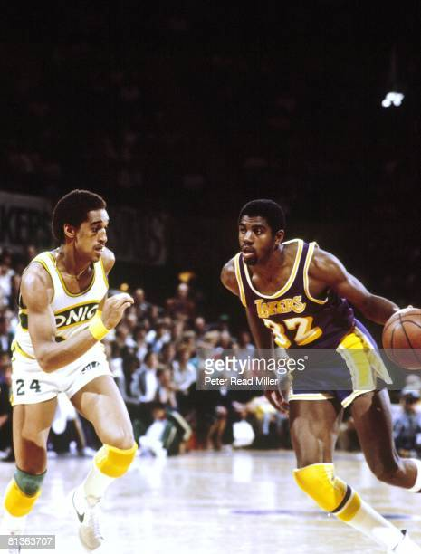 Basketball NBA Playoffs Los Angeles Lakers Magic Johnson in action vs Seattle SuperSonics Dennis Johnson Game 3 Seattle WA 4/25/1980
