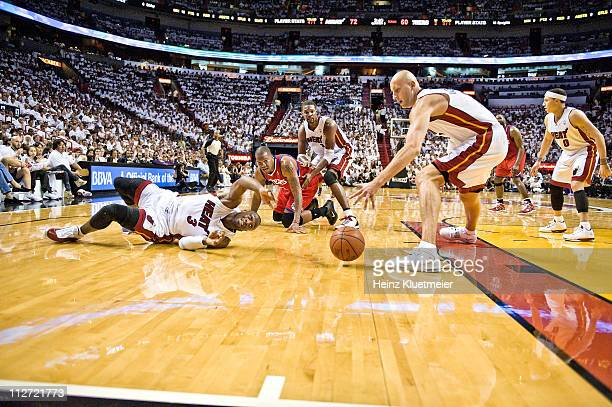 NBA Playoffs Miami Heat Dwyane Wade and Zydrunas Ilgauskas in action getting loose ball vs Philadelphia 76ers Marreese Speights as Heat's Chris Bosh...