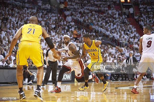 NBA Playoffs Miami Heat LeBron James in action vs Indiana Pacers Paul George at American Airlines Arena Game 6 Miami FL CREDIT Heinz Kluetmeier