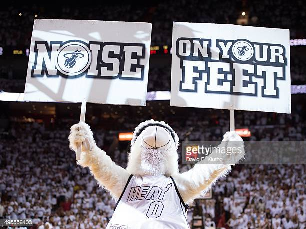 NBA Playoffs Miami Heat mascot Burnie holding up signs that read NOISE and ON YOUR FEET in stands during game vs Indiana Pacers at American Airlines...