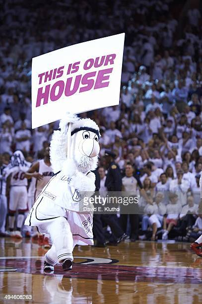 NBA Playoffs Miami Heat mascot Burnie on court with sign reading THIS IS OUR HOUSE during Game 3 vs Indiana Pacers at American Airlines Arena Miami...