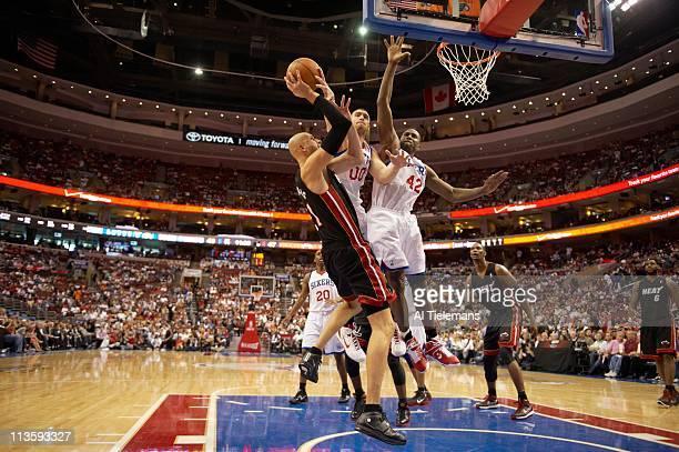 NBA Playoffs Miami Heat Zydrunas Ilgauskas in action vs Philadelphia 76ers Spencer Hawes and Elton Brand at Wells Fargo Center Game 4Philadelphia PA...