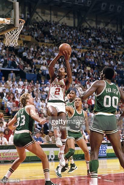 NBA Playoffs Milwaukee Bucks Junior Bridgeman in action shot vs Boston Celtics Dennis Johnson and Larry Bird at MECCA Arena Game 3 Milwaukee WI...