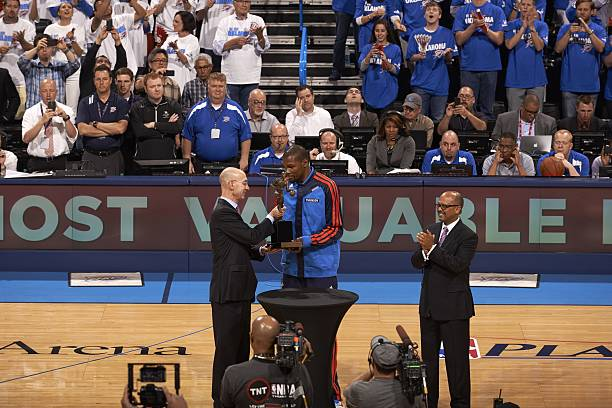 7910f7a68ea5 Oklahoma City Thunder Kevin Durant (35) receiving MVP award from NBA  commissioner Adam Silver