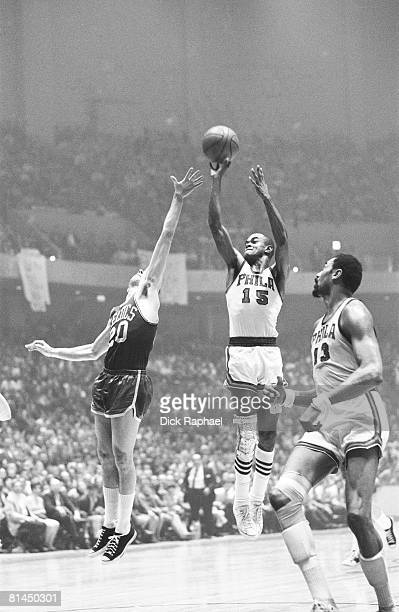 Basketball NBA Playoffs Philadelphia 76ers Hal Greer takes the shot as Larry Siegfried of the Boston Celtics goes for the block during their game on...