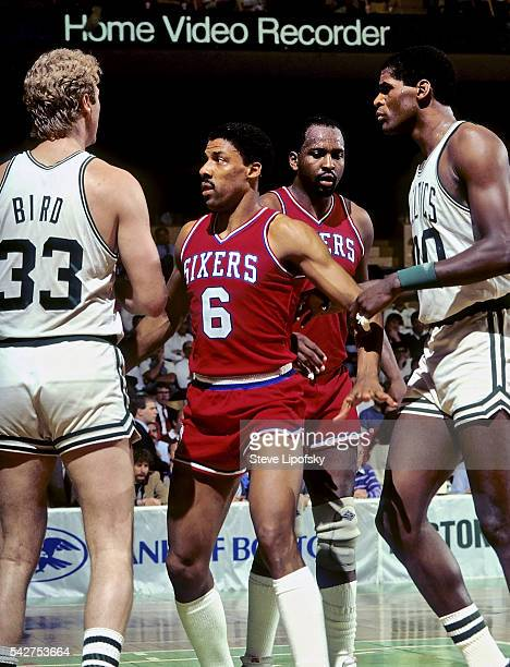 NBA Playoffs Philadelphia 76ers Julius Erving and Moses Malone during confrontation vs Boston Celtics Larry Bird and Robert Parish at Boston Garden...