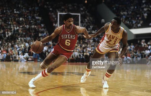 NBA Playoffs Philadelphia 76ers Julius Erving in action vs Atlanta Hawks Jack Givens at Omni Coliseum Game 3 Atlanta GA CREDIT Carl Skalak