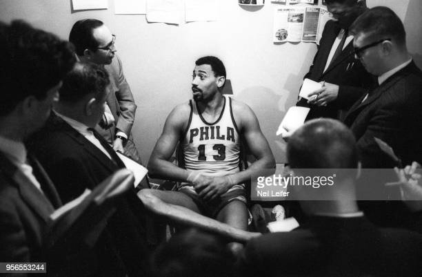 NBA Playoffs Philadelphia 76ers Wilt Chamberlain victorious in locker room with press and media after winning Game 5 and series vs Boston Celtics at...