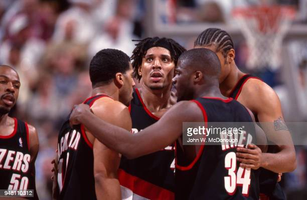 NBA Playoffs Portland Trail Blazers Brian Grant Isaiah Rider and Jim Jackson in huddle during game vs Utah Jazz at Delta Center Game 2 Salt Lake City...