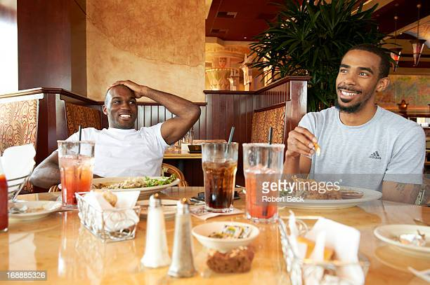 NBA Playoffs Portrait of Memphis Grizzlies Quincy Pondexter and Mike Conley casual eating lunch during practice day at Cheesecake Factory Behind the...