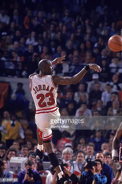 Basketball NBA playoffs Rear view of Chicago Bulls Michael Jordan in action making pass vs New York Knicks Chicago IL 6/4/1993