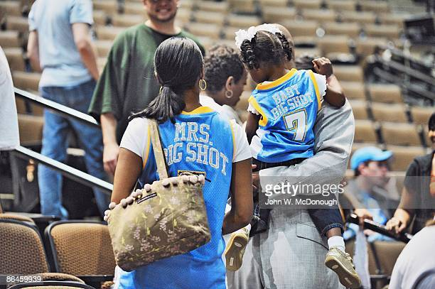 NBA Playoffs Rear view of Denver Nuggets Chauncey Billups casual with his wife Piper and 2yearold daughter Cenaiya after Game 1 vs Dallas Mavericks...